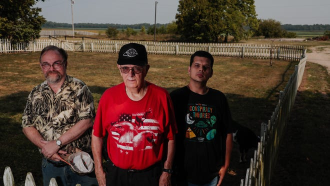 Three Circleville residents who are members of the Roundtown UFO Society -- from left, Jon Fry, Pete Hartinger and Cameron Jones -- visit what used to be the Pickaway County farm of Bruce Stevenson, who said that in 1948 he saw an unidentified flying object there.