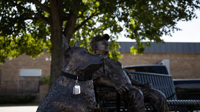 Bronze statues of a K-9 and Denny Craycraft were unveiled Sept. 7 at the Denny Craycraft Veterans Freedom Park in Belding.