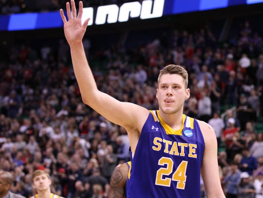 South Dakota State's Mike Daum waves to the SDSU fans
