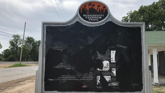 The Emmett Till historical sign has been scraped almost completely of text and photographs. It was erected in 2011, the first on the Mississippi Freedom Trail.