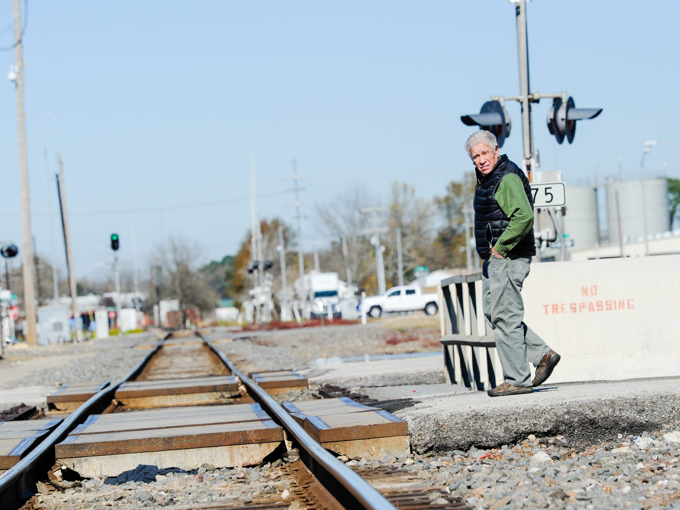 Harold Schoeffler walks along the railroad tracks that