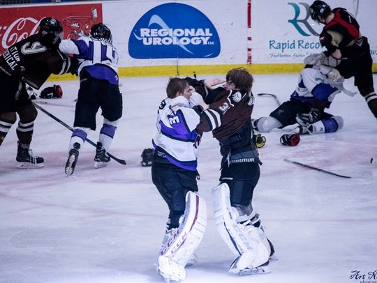 Mudbugs goalie Gustavs Grigals fights his counterpart