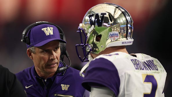 Head coach Chris Petersen of the Washington Huskies talks with quarterback Jake Browning #3 during the second half of the Playstation Fiesta Bowl against the Penn State Nittany Lions at University of Phoenix Stadium on December 30, 2017 in Glendale, Arizona. The Nittany Lions defeated the Huskies 35-28.