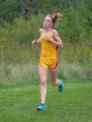 Divine Savior Holy Angels junior Meghan Scott won the WIAA Division 1 state cross country title Saturday at Ridges Golf Course in Wisconsin Rapids.