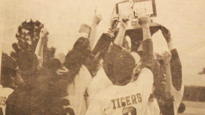 Two in a row. The Tigers celebrate with the Class AA state championship trophy Saturday (June 6, 1987) evening after defeating Rocky Ford 5-3 at Butch Butler Field in Greeley. It was the first time in four tries that the Tigers beat Rocky Ford this season. The Tigers won the Class AAA state title in 1981 and the Class AA title in 1986.