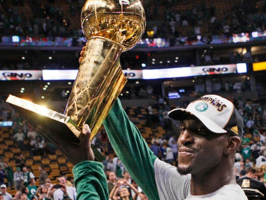 Boston Celtics' Kevin Garnett holds the NBA Championship