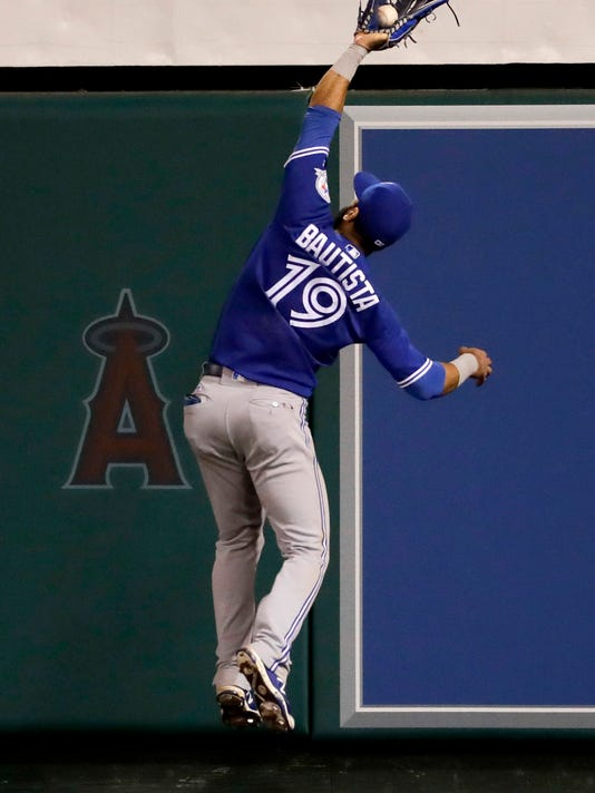 Toronto Blue Jays right fielder Jose Bautista catches a fly ball hit by Los Angeles Angels' Mike Trout during the eighth inning of a baseball game in Anaheim, Calif., Thursday, Sept. 15, 2016. (AP Photo/Chris Carlson)