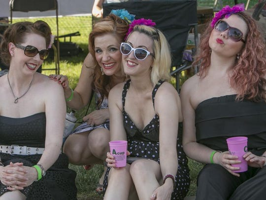 Hotsy Totsy takes a break from their Andrews Sisters-inspired music to enjoy the festival.