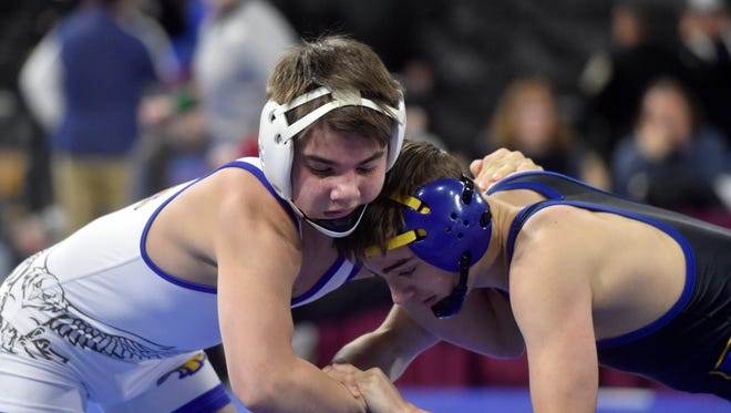Lewistown's Cooper Birdwell wrestles Libby/Troy's Buddy Doolin in the Class A 113-pound championship match at the 2018 all-class state wrestling tournament at MetraPark in Billings last February.