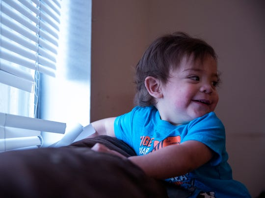 Julius Lopez, 1, plays in his four-bedroom apartment at the Rincon Point Apartments on Monday, May 21, 2018. Their family of nine is unsure of what will happen due to the pending foreclosure on their property.