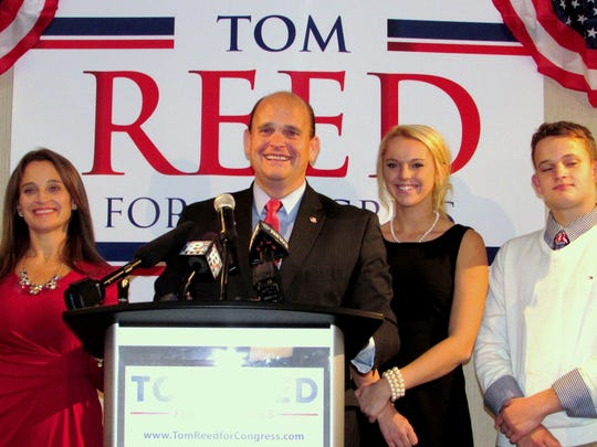 U.S. Rep. Tom Reed, joined by his family, gives a victory speech after winning re-election in 2014.