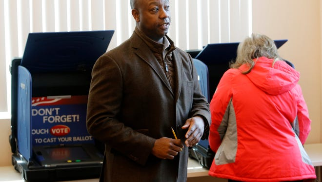 Sen. Tim Scott, R-S.C. walks away after voting at Hanahan Fire Station #3 in Hanahan, S.C., Tuesday, Nov. 8, 2016. Scott waited about an hour in line to vote. (AP Photo/Mic Smith)