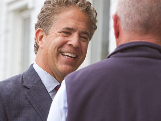 U.S. Rep. Mike Bishop talks with Joe Parker outside the Greater Brighton Area Chamber of Commerce after an event held there celebrating Bishop's endorsement by the U.S. Chamber of Commerce.
