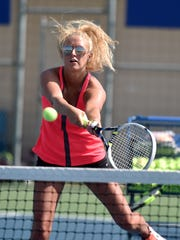 Centerville High School tennis player Shelby Good returns