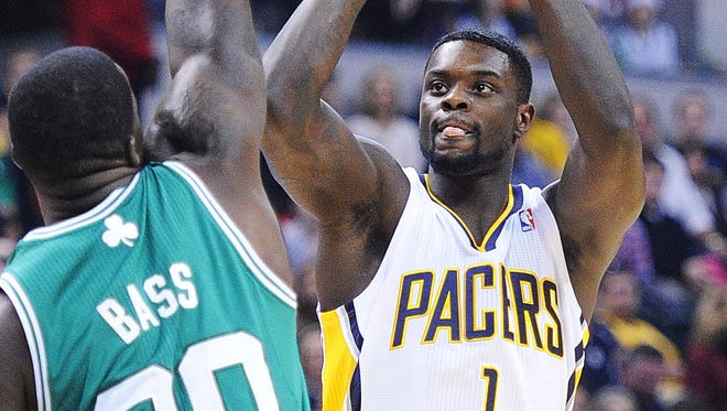 Lance Stephenson shoots over Celtic defender Brandon Bass. The Pacers hosted the Boston Celtics in NBA action at Bankers Life Fieldhouse Sunday December 22, 2013.