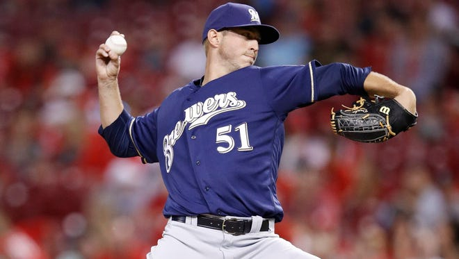 Brewers reliever Oliver Drake pitches the ninth against the Reds earlier this season.