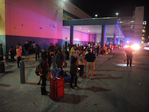 Stranded Ft. Lauderdale airport passengers wait for
