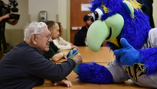 Donald Cook, 82 of West York, arm-wrestles with York Revolution mascot DownTown Thursday, April 20, 2017, at WellSpan Surgery and Rehabilitation Hospital in York Township. The York Revolution, which opens its 11th season on April 21, annually visits WellSpan patients before beginning each season.