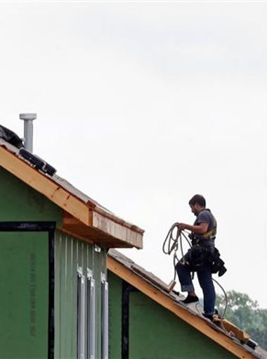 In this photo taken Tuesday, June 9, 2015, a roofer works on a home under construction in the Briar Chapel community in Chapel Hill, N.C. U.S. builders started work on single-family houses last month at the fastest pace since the Great Recession began in late 2007. Housing starts in August rose 0.2 percent to a seasonally adjusted annual rate of 1.21 million homes, the Commerce Department said Tuesday. Construction of single-family houses accounted for all of the gains, shooting up 12.8 percent last month to the highest rate since December 2007.