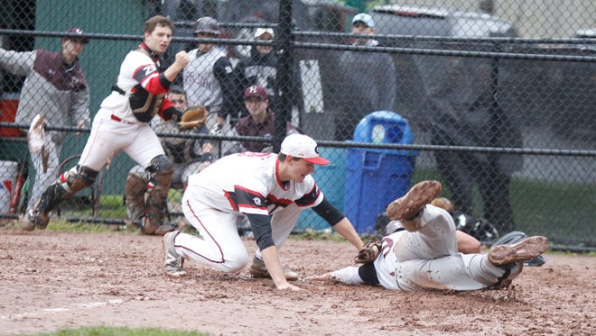 Rye pitcher George Kirby tags out Harrison's Christos Siapanides at home plate during Wednesday's game at Disbrow Park in Rye.  The Garnets won 3-0.