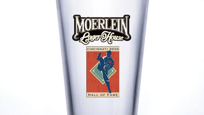 A commemorative pint glass featuring the Moerlein Lager House and Reds Hall of Fame logos.