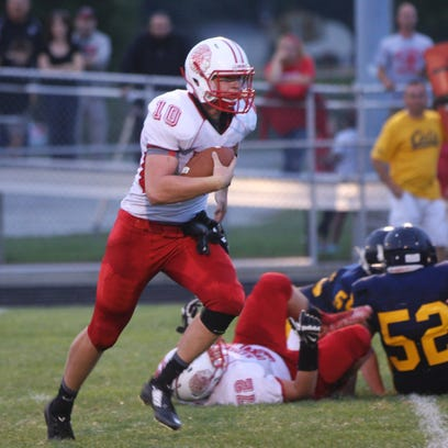 Port Clinton's Joey Brenner rushes for yardage against