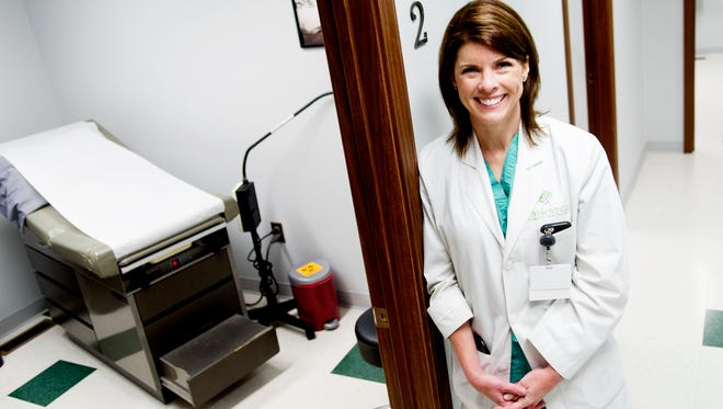 Dr. Jennifer Maddron poses for a portrait at her practice in Sevierville, Tennessee on Tuesday, May 2, 2017. Dr. Maddron is among a small number of OB-GYN's in the state (and country) to undergo the certification process to be able to dispense medication assistance therapy (an alternative to opioids that helps women wean off them). She also has started a support group for addicted patients, requires regular pill checks, recovery attendance and counseling.