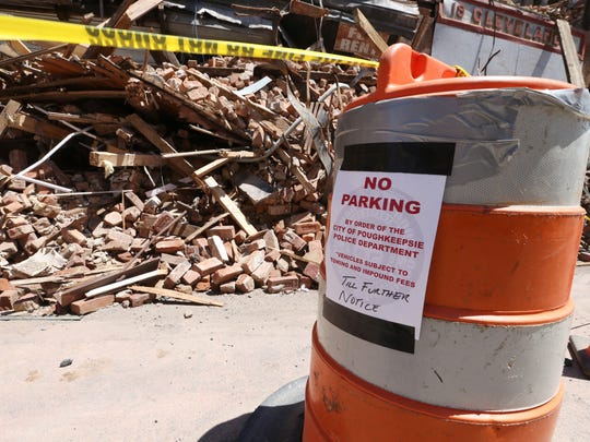 An order of no parking in front of rubble from the