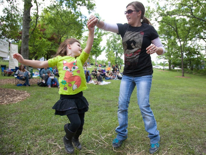 Taylor Thompson, age 5, spins while dancing with her mom Nicole Thompson. May 17, 2014