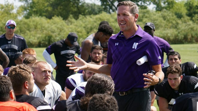 In this image provided by Northwestern University Athletics, Northwestern senior associate athletic director for health, safety and performance Tory Lindley addresses the Wildcats' football team after NCAA college football practice in Kenosha, Wis. Lindley is the president of the National Athletic Trainers Association, which has put together an app to help athletic trainers assist understaffed hospitals and health care systems during the COVID-19 pandemic.