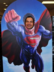 Owner Peter Pappas clowns around with a life size cutout of Superman. Viera Comics has opened at the Park Place at Suntree at 7640 North Wickham Road, next to Tuscany Grill. Their grand opening will be Oct.10.
