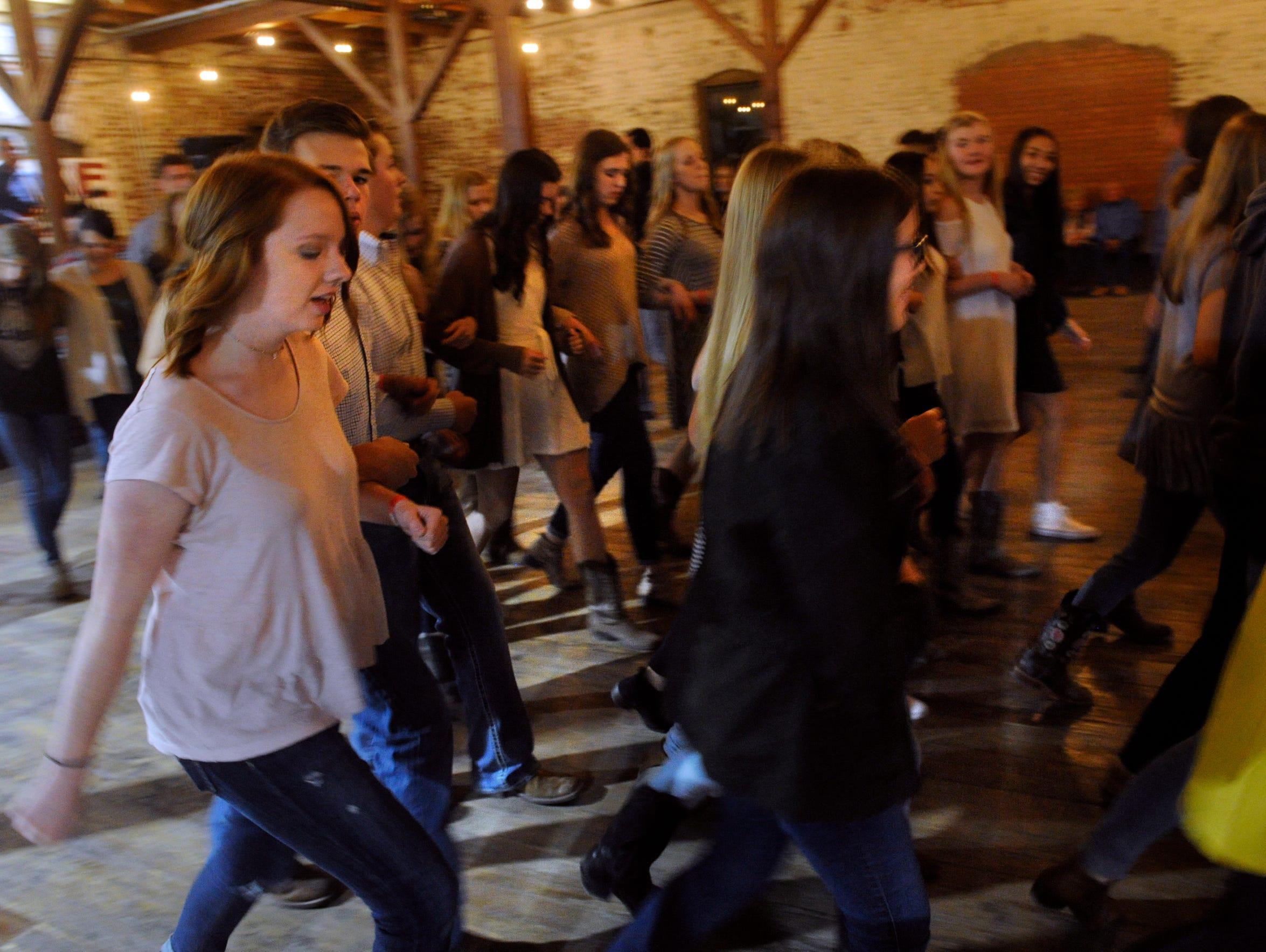 "Dancers promenade around the floor as the band plays ""Orange Blossom Special"" Nov. 18 at Eller Hall."