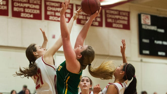 Champlain Valley's Abby Thut, left, blocks the shot by BFA-St. Albans' Kim Howrigan during a girls basketball game at Champlain Valley Union High School on Thursday.