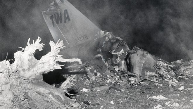 The tail of a TWA jet remains in the wreckage of Flight 128 that crashed Nov. 20, 1967, near the Cincinnati/Northern Kentucky International Airport, then known as Greater Cincinnati Airport.