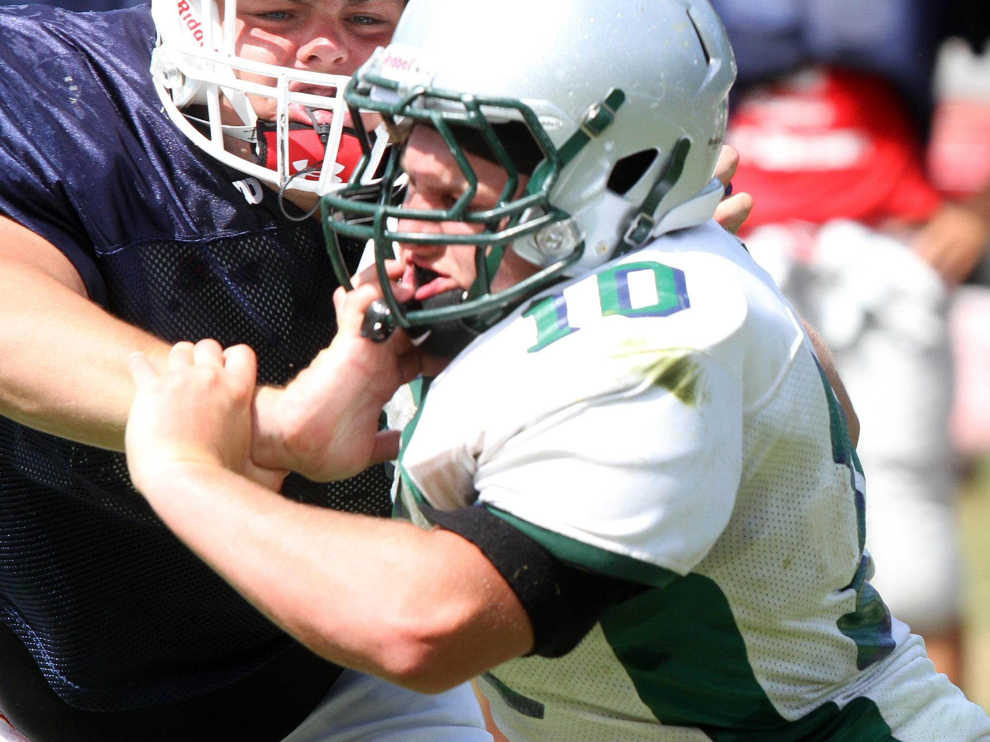 Manalapan offensive lineman Joe Sellmeyer (left) blocks Colts Neck's Joe Giacalone during a scrimmage Aug. 27.