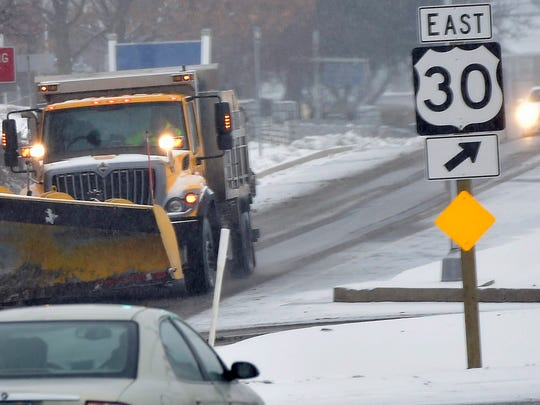 A PennDOT plow travels along Lincoln Way West near Sollenberger Road Monday, Feb. 15, 2016. Light snow and freezing rain continued for most of the day.