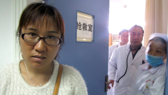 Li Jinmei's husband, Pan Huabing, was badly hurt in the March 1 terror attack. He was injured protecting their 6-year-old daughter from an attacker's blow.