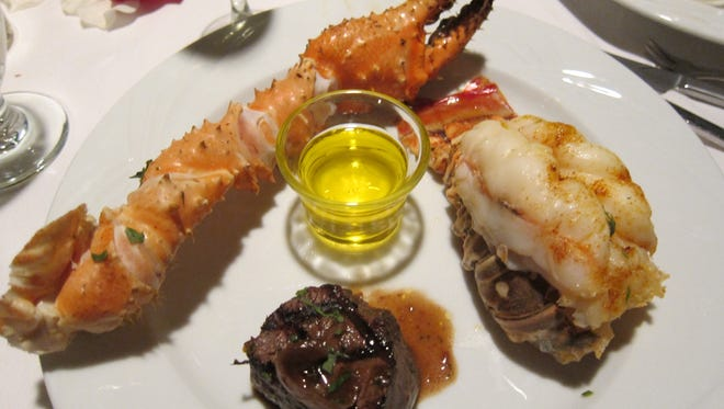 The most popular item is the lobster tail, which regulars come back for again and again, shown here with a filet mignon and Alaskan King crab claw.