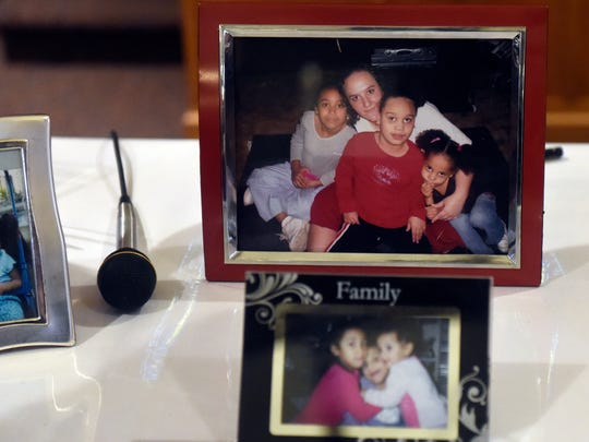 Family photos featuring Aleah Beckerle are on display during a birthday party and service for the missing girl who turns 20 this week at St. Lucas United Church of Christ in Evansville Saturday.  About 50 people attended the event for Beckerle who was reported missing July 17.