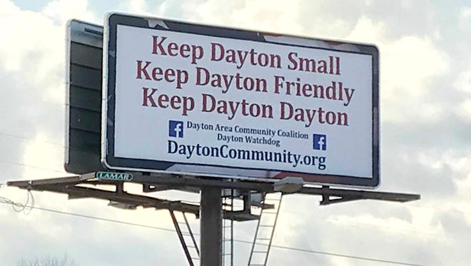 """The billboard along Indiana 38, outside Dayton, is the latest from """"Keep Dayton Small"""" proponents in a debate over growth in the small town just east of Lafayette."""