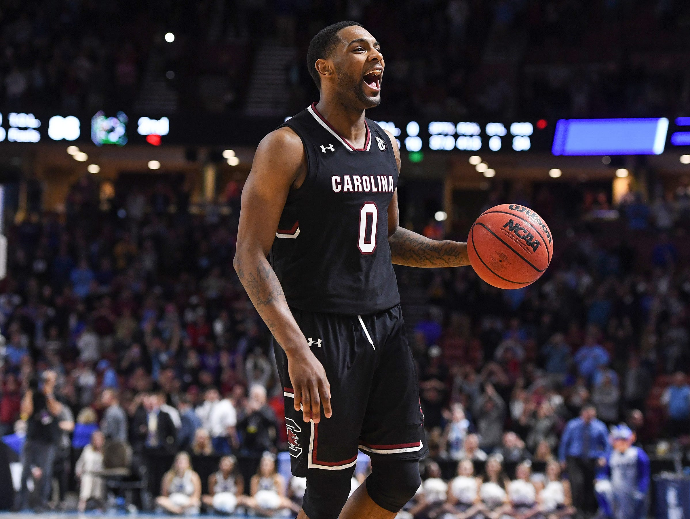 South Carolina guard Sindarius Thornwell (0) reacts after the Gamecocks defeated Duke 88-81 in the 2nd round of the NCAA Tournament at Bon Secours Wellness Arena in downtown Greenville on Sunday, March 19, 2017.
