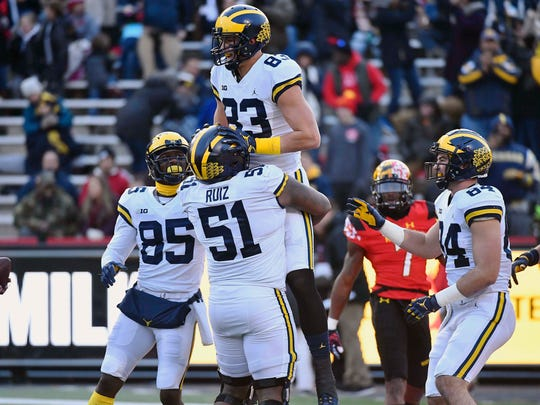 Michigan tight end Zach Gentry (83) is congratulated by teammates after scoring a touchdown against Maryland during the first half on Saturday, Nov. 11, 2017, in College Park, Md.