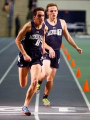 Mendham senior Colin Hall hands off to classmate Val