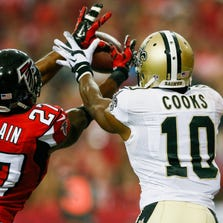 ATLANTA, GA - SEPTEMBER 07:  Robert McClain #27 of the Atlanta Falcons intercepts a touchdown intended for Brandin Cooks #10 of the New Orleans Saints in the second half at the Georgia Dome on September 7, 2014 in Atlanta, Georgia.  (Photo by Kevin C. Cox/Getty Images)