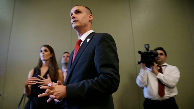 In this file photo taken Aug. 25, 2015, Republican presidential candidate Donald Trump's campaign manager Corey Lewandowski watches as Trump speaks in Iowa.
