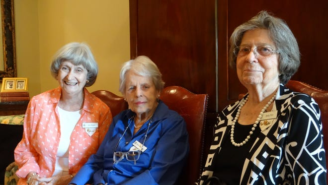 P.E.O. Chapter AE members Ann Hargon, Stella McStravick, and Betty Farr enjoyed guessing the identities of the baby pictures that members had submitted.