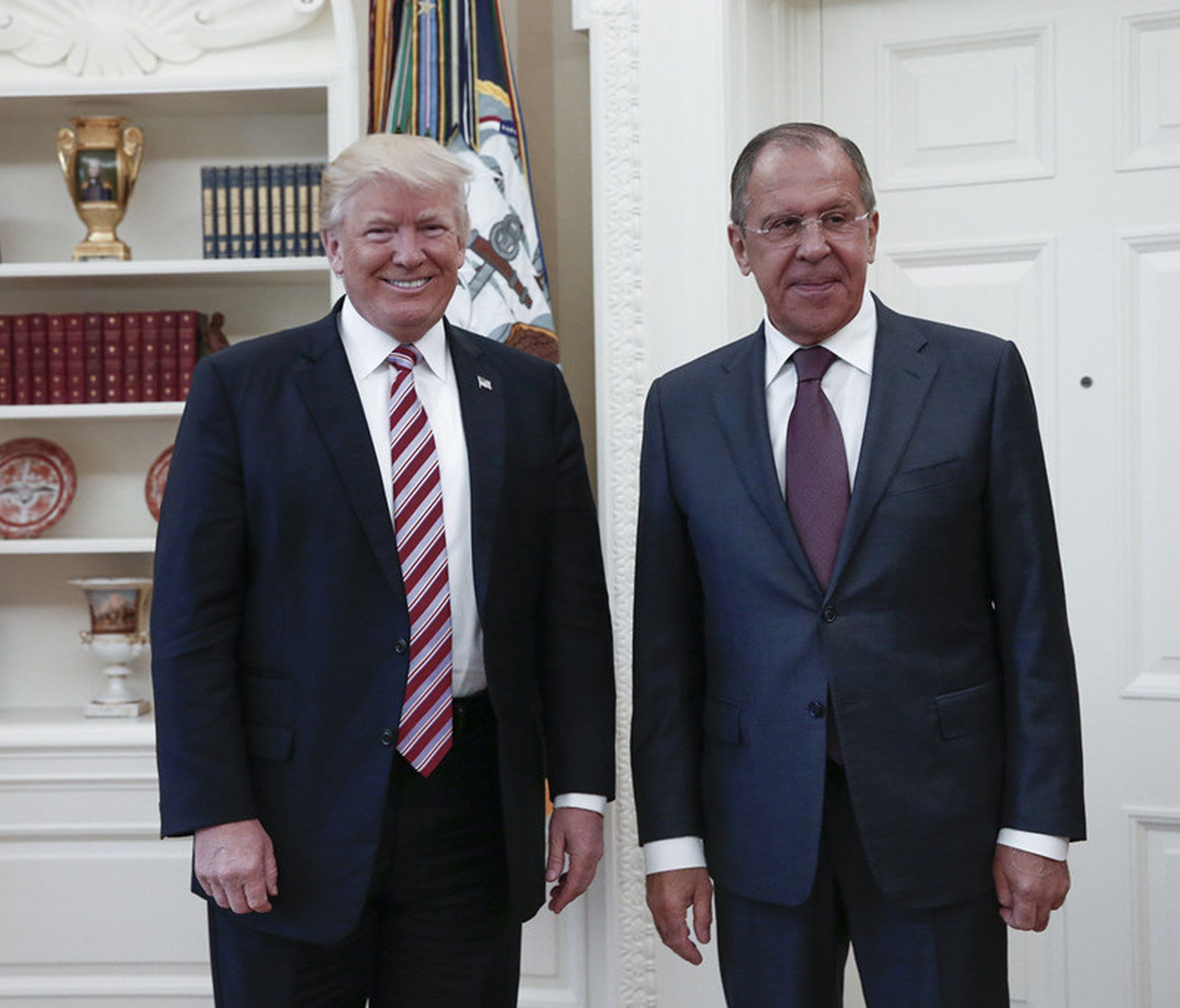 This file handout photo taken on May 10, 2017 made available by the Russian Foreign Ministry shows shows US President Donald J. Trump posing with Russian Foreign Minister Sergei Lavrov during their meeting at the White House. (Editor's note: USA TODA