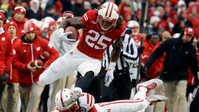 Wisconsin's Melvin Gordon (25) breaks away from Nebraska's Corey Cooper for a 62-yard touchdown run during the first half.