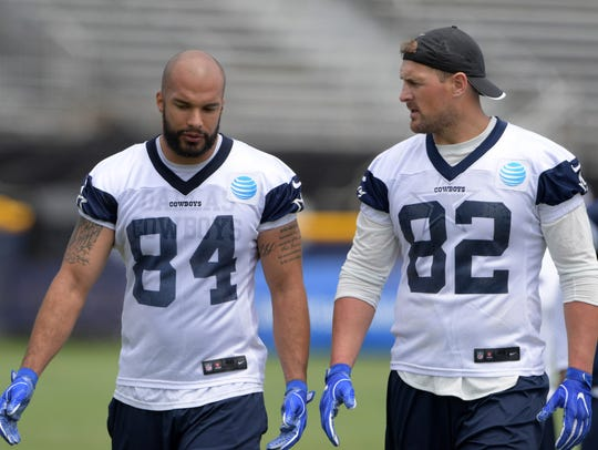 Jason Witten (82) talks with fellow tight end James