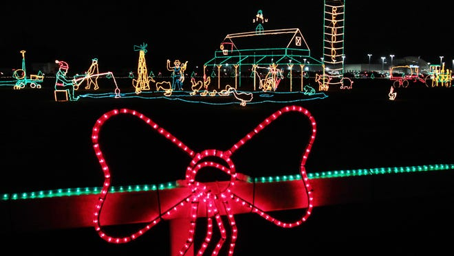 The Reynolds Farm Equipment Christmas Lights display in Fishers opened to the public on Tuesday, Nov. 26, 2013. The annual free display, along Ind. 37, was lit up by company matriarch Arline Reynolds, 94, at 5:15 p.m.